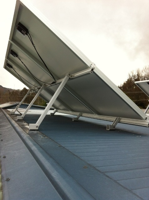 Support legs installed too low on the panel - causing wind load stress on top of the panel