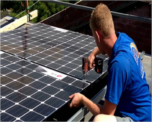 Beacon Solar staff install LG solar panels